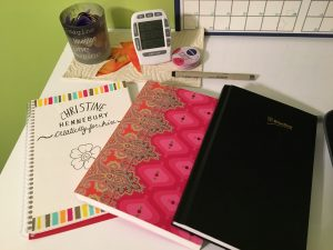 Notebooks, pen, lipgloss, timer, candle.  It's the stuff I need to get stuff done.