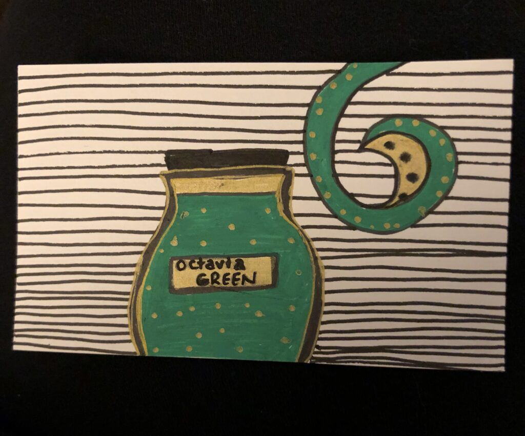 A drawing of an inkwell filled with green ink and a green and gold octopus tentacle.